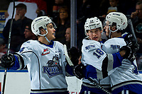 KELOWNA, BC - MARCH 11: Kaid Oliver #34, Tarun Fizer #18 and another player of the Victoria Royals celebrate a second period goal against the Kelowna Rockets at Prospera Place on March 11, 2020 in Kelowna, Canada. (Photo by Marissa Baecker/Shoot the Breeze)