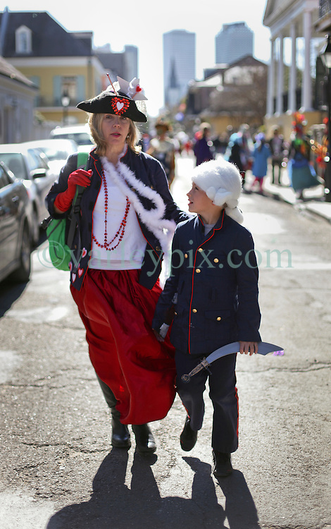 09 February 2016. New Orleans, Louisiana.<br /> Mardi Gras Day. Ben and Michelle quitting early heading out of the French Quarter. <br /> Photo©; Charlie Varley/varleypix.com
