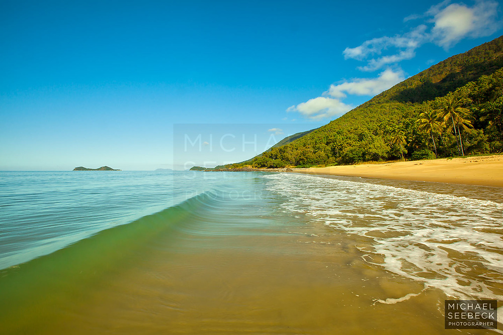 Small waves wash on to a beach just to the north of Ellis Beach.<br /> <br /> Open Edition Print / Stock Image