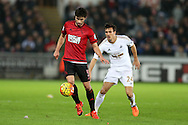 Claudio Yacob of West Bromwich Albion (l) holds off Jack Cork of Swansea city. Barclays Premier league match, Swansea city v West Bromwich Albion at the Liberty Stadium in Swansea, South Wales  on Boxing Day Saturday 26th December 2015.<br /> pic by  Andrew Orchard, Andrew Orchard sports photography.