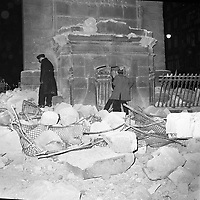 Firemen search the rubble after the explosion that destroyed Nelson's Pillar. Nobody was harmed although the structure was so damaged it was demolished by another explosion detonated by the army six days later. (Part of the Independent Newspapers/NLI Collection)