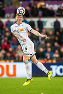 Alfie Mawson of Swansea City in action. Premier league match, Swansea city v Leicester city at the Liberty Stadium in Swansea, South Wales on Saturday 21st October 2017.<br /> pic by Aled Llywelyn, Andrew Orchard sports photography.