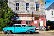 old Chevy Bel Air and Colorful historic storefronts along the Main Street in Kathryn, North Dakota, USA