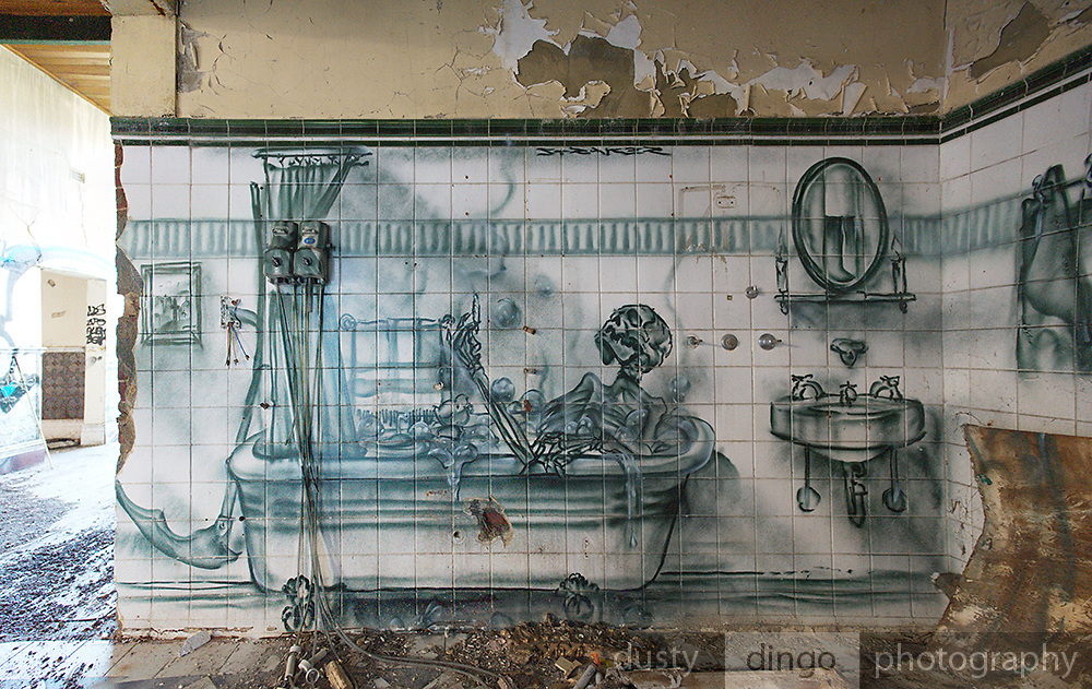 Post-fire graffiti in the derelict, arson-destroyed Guildford Hotel, Guildford, Western Australia