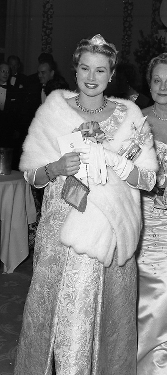 PRINCESS GRACE OF MONACO seated at the Monte Carlo Rose Ball on 7th February 1958.