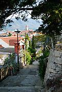 Shady lane overlooking Korcula old town, island of Korcula, Croatia