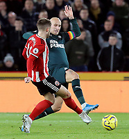 SHEFFIELD, ENGLAND - DECEMBER 05: <br /> Sheffield United's Oliver Norwood threads a pass despite the attentions of Newcastle United's Jonjo Shelvey<br /> during the Premier League match between Sheffield United and Newcastle United at Bramall Lane on December 5, 2019 in Sheffield, United Kingdom. (Photo by Rich Linley - CameraSport via Getty Images)