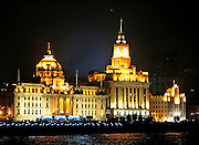 HSBC Bank (left) and the Customs house (right) stand on the famous waterfront called 'The Bund' in Shanghai, China, on September 19, 2008. Photo by Lucas Schifres/Pictobank