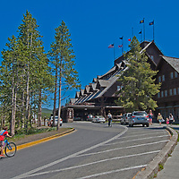 Tourists approach historic Old Faithful Inn, Yellowstone National Park, Wyoming.