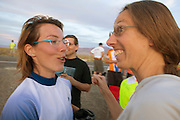 Barbara Buatois (links) feliciteert Ellen van Vugt met haar race op de vijfde racedag van de WHPSC. In de buurt van Battle Mountain, Nevada, strijden van 10 tot en met 15 september 2012 verschillende teams om het wereldrecord fietsen tijdens de World Human Powered Speed Challenge. Het huidige record is 133 km/h.<br /> <br /> Barbara Buatois congratulates Ellen van Vugt with her race on the fifth day of the WHPSC. Near Battle Mountain, Nevada, several teams are trying to set a new world record cycling at the World Human Powered Vehicle Speed Challenge from Sept. 10th till Sept. 15th. The current record is 133 km/h.