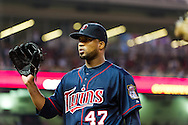 Minnesota Twins starter Francisco Liriano acknowledges the crowd after pitching 8 innings and striking out a career-high 15 batters against the Oakland Athletics on July 13, 2012 at Target Field in Minneapolis, Minnesota.  The Athletics defeated the Twins 6 to 3.  © 2012 Ben Krause