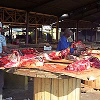 Africa, Namibia, Windhoek. Preparing kapana, red meat for grilling, in the open market of Katutura in Windhoek.