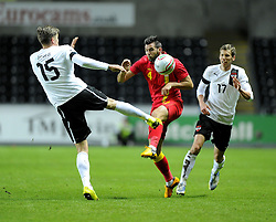 Joe Ledley (Celtic) of Wales is fouled by Sebatian Prodl (Werder Bremen) of Austria  - Photo mandatory by-line: Joe Meredith/JMP - Tel: Mobile: 07966 386802 06/02/2013 - SPORT - FOOTBALL - Liberty Stadium - Swansea  -  Wales V Austria - International Friendly