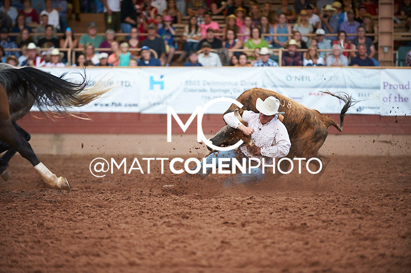Steer wrestler Aaron Vosler of Cheyenne, WY competes at the Pikes Peak or Bust Rodeo in Colorado Springs, CO.<br /> <br /> <br /> UNEDITED LOW-RES PREVIEW<br /> <br /> <br /> File shown may be an unedited low resolution version used as a proof only. All prints are 100% guaranteed for quality. Sizes 8x10+ come with a version for personal social media. I am currently not selling downloads for commercial/brand use.