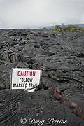 old trail marker sign buried in fresh lava flow, west of Kalapana, Puna, Hawaii Island ( the Big Island ), Hawaiian Islands, U.S.A.