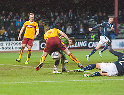 Motherwell's keeper Dan Twardzik and Mark O'Brien clash and the the ball ends up in the net for Dundee's fourth goal. <br /> Dundee 4 v 1 Motherwell, SPFL Premiership played 10/1/2015 at Dundee's home ground Dens Park.