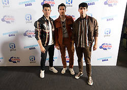 Members of the band the Jonas Brothers (left to right) Nick Jonas, Kevin Jonas and Joe Jonas on the red carpet of the the media run during Capital's Summertime Ball. The world's biggest stars perform live for 80,000 Capital listeners at Wembley Stadium at the UK's biggest summer party.
