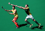 1-Press Photographer Of The Year, 5-SPORTS.Paul Kane.Getty Images.Brent Dancer of Australia traps the ball ahead of Miquel Delas of Spain during the first test match between the Australian Kookaburras and Spain at Perth Hockey Stadium.