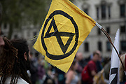 Climate change activists from the Extinction Rebellion group at Parliament Square in protest that the government is not doing enough to avoid catastrophic climate change and to demand the government take radical action to save the planet, on 23rd April 2019 in London, England, United Kingdom. Extinction Rebellion is a climate change group started in 2018 and has gained a huge following of people committed to peaceful protests.