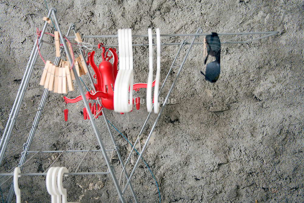 clothing drying rack against a concrete floor