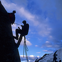 Climbers rappel off a crag in Bugaboo Provincial Park in the Purcell Mountains of British Columbia, Canada.