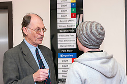 Defendant outside court speaking to the duty solicitor in Sheffield