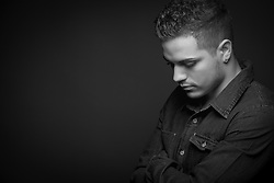 Black and white portrait teenage boy serious sad