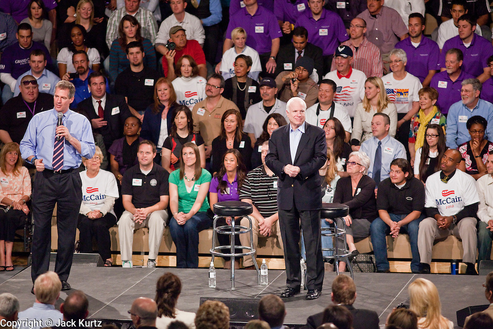 05 MARCH 2010 -- PHOENIX, AZ: Senators Scott Brown and John McCain on stage at McCain's election rally at Grand Canyon University in Phoenix Friday.  McCain is facing a tough primary battle from former Republican Congressman JD Hayworth. McCain has Scott Brown (R-MA) and Sarah Palin campaigning for him. Both men are courting the Tea Party activists but so far the Tea Party has refused to endorse either candidate.   PHOTO BY JACK KURTZ