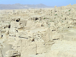 July 13, 2017 - Turpan, Turpan, China - Turpan, CHINA-July 11 2017: (EDITORIAL USE ONLY. CHINA OUT) ..Gaochang, also known as Kocho or ''King City'', is the site of an ancient oasis city built on the northern rim of the inhospitable Taklamakan Desert in Xinjiang, China. Ancient Gaochang City, built in the 1st century BC, served long as a busy important trading center, and a stopping point for merchant traders traveling on the Silk Road. It was burnt down in wars in the 14th century. Old palace ruins inside and outside the city, located 30 km southeast of modern Turpan, can still be seen today. (Credit Image: © SIPA Asia via ZUMA Wire)