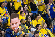 Golden State Warriors fans hold a giant Golden State Warriors guard Stephen Curry (30) head during Game 2 of the Western Semifinals against the New Orleans Pelicans at Oracle Arena in Oakland, California, on May 1, 2018. (Stan Olszewski/Special to S.F. Examiner)