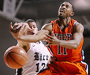 Feb 1, 2012; Houston, TX, USA; Rice Owls forward Jarelle Reischel (12) blocks a shot attempt by UTEP Miners guard Jacques Streeter (11) during the second half at Tudor Fieldhouse. Rice won 77-75. Mandatory Credit: Thomas Campbell-US Presswire