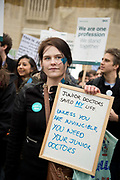 Fourth 48 hour strike by junior doctors over proposed changes to their contracts with the NHS on Westminster April 6th 2016 in Westminster, London, United Kingdom. A woman patient joined the demonstrators in Whitehall, holding a placard saying 'Junior doctors saved my life'.