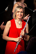 Flutist Bethany Ackeret, featured soloist, at the 2019 Tudor Holiday Dinner Concerts in Great Hall of the Wisconsin Memorial Union. She accompanied the Philharmonic Chorus of Madison on two program selections, and when not accompanying the chorus, she sings soprano in the chorus. Photo taken December 6, 2019, during the third of five concerts.
