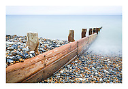 Weather worn breakwater. I love the colours, shapes, and the stillness you often find on Worthing beach.<br /> Photograph by Christopher Ison ©<br /> 07544044177<br /> chris@christopherison.com<br /> www.christopherison.com