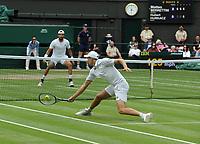 Lawn Tennis - 2021 All England Championships - Week Two - Friday - Wimbledon<br /> Mens Semi Final - Matteo Berrettini v Hubert Hurkacz<br /> <br /> Hubert Hurkacz  returns to Matteo Berrettini of Italy<br /> <br /> <br /> Credit : COLORSPORT/Andrew Cowie