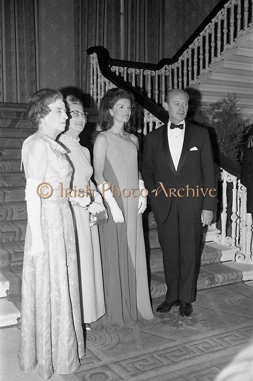 An Taoiseach Mr. Jack Lynch T.D. entertains  Mrs. Jackie Kennedy at a reception at St. Patrick's Hall, Dublin Castle. Jackie Kennedy with her hosts Jack Lynch and his wife in the reception hall of Dublin Castle where she attended her first formal function since her arrival in Ireland. On the left is Mrs. Frank Aiken...30.06.1967