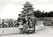 posing in front of Kumamoto castle Japan 1960s