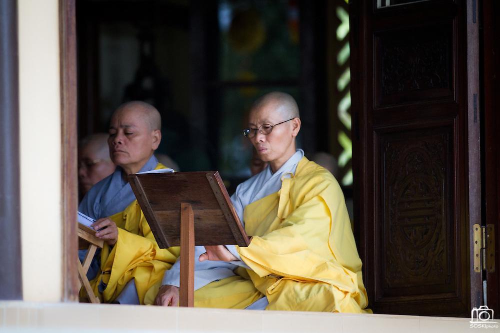 Buddhist monks and nuns pray at the Chua Dieu Vien Pagoda in Hue, Vietnam.  Photo by Stan Olszewski/SOSKIphoto