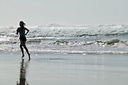 Woman running on beach. Samurai Beach, Port Stephens, East Coast Australia