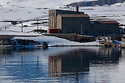 Old coal grading buildings and old power station, Ny Alesund, Svalbard. The coal mine, and the settlement were abandonded in 1963, after the Kings Bay Affair - 71 people were killed in accidents in the coal mines in between 1945 and 1963, and the Norwegian government resigned following an investigation. 21 people died in the 1962 accident. The mine closed down, and was later supplanted by the scientific research basis that exists today