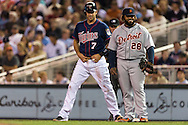 Joe Mauer (7) of the Minnesota Twins and Prince Fielder (28) of the Detroit Tigers share a smile during a game on August 14, 2012 at Target Field in Minneapolis, Minnesota.  The Tigers defeated the Twins 8 to 4.  Photo: Ben Krause