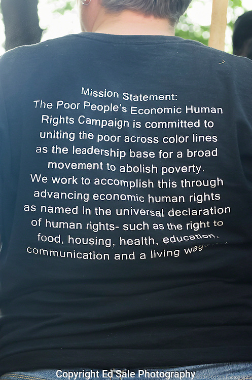 A protester at a 2015 May Day rally in Portland, Oregon wears a t-shirt with a message on the back describing The Poor People's Economic Human Rights Campaign to abolish poverty.