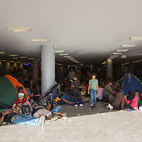 Illegal migrants take a rest in an underground corridor near a transit zone at the main railway station Keleti in Budapest, Hungary on September 02, 2015. ATTILA VOLGYI