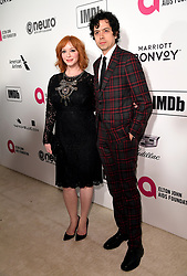 Christina Hendricks and Geoffrey Arend attending the Elton John AIDS Foundation Viewing Party held at West Hollywood Park, Los Angeles, California, USA.