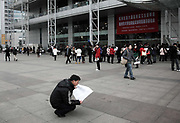 University students looking for jobs at a fair in Hangzhou, China on 27 January 2010.  As China has rapidly expanded college enrollment in recent years, resulting in 6.1 million college graduates in 2009 compared with only 850,000 ten years ago, it is increasingly becoming difficult for graduates to find jobs, while starting average salary has actually dropped in the last few years.