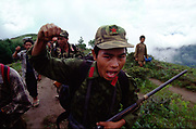 A Moaist rebel chants slogans as thousands gather for a rally in Dolakha, Nepal
