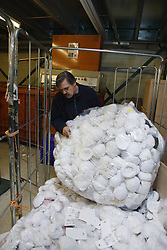 Man with a mild learning disability working as a factory operative, shown here recycling paper, helped into employment by the Ready 4 Work team, Nottinghamshire County Council