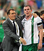 Football - European Championships 2012 - Italy vs Ireland<br /> <br /> Ireland assistant coach Marco Tardelli comforts Richard Dunne at the final whistle at the Municipal Stadaium, Poznan