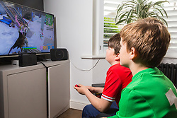 Brothers Indy, 7, in green, and Leo, 12 enjoy gaming in the sitting room. Real-life case study campaign, showcasing BT's complete Wi-Fi offering. London, May 16 2019.