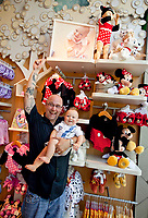 Dad Clayton Schuster holds his son Ferdinand as he poses for a picture for his wife at the new Disney Baby store at Americana in Glendale, CA.  September 8,  2012. The baby modeled for the photo above them.  Photo by David Sprague